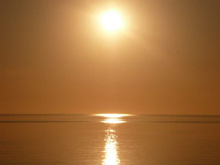 Fotka západu slunce nad mořem