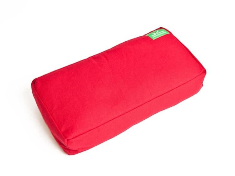 Růžový podpůrný polštář na jógu